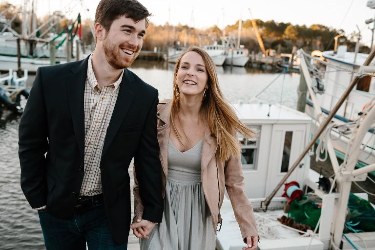 Turner and Megan hold hands leaving boat slip at the end of Market St in Apalachicola