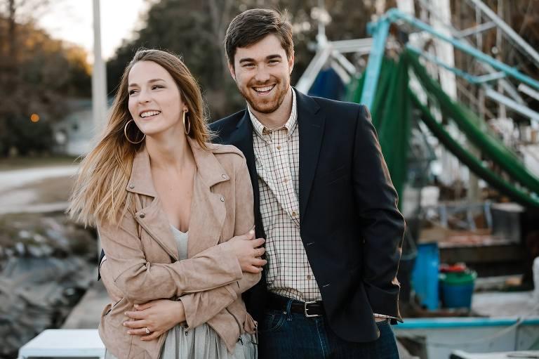 Megan and Turner and walking along marina near shimp boats