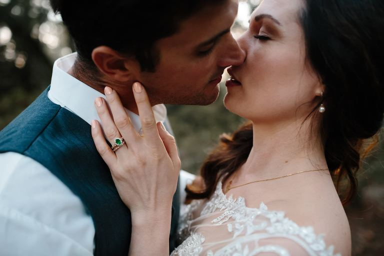 Close up of newlywed couple just about to kiss as dusk in Eden Gardens State Park