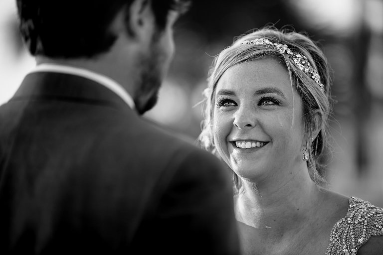 Black and white portrait of bride crying durning ceremony on the beach at Sheraton Bay Point Resort in Panama City Beach