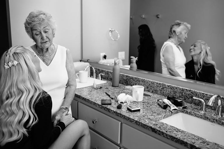 Black and white of Bride and Grandmother laughing during bridal prep