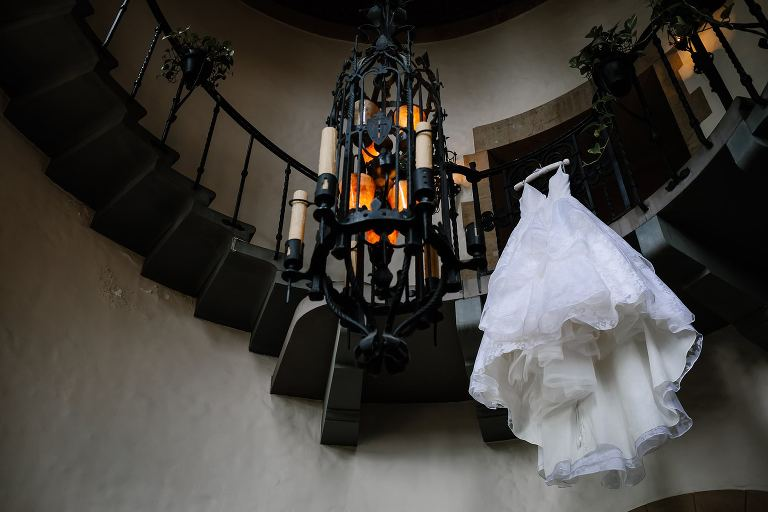 Wedding dress hanging from Graylyn circular staircase balcony