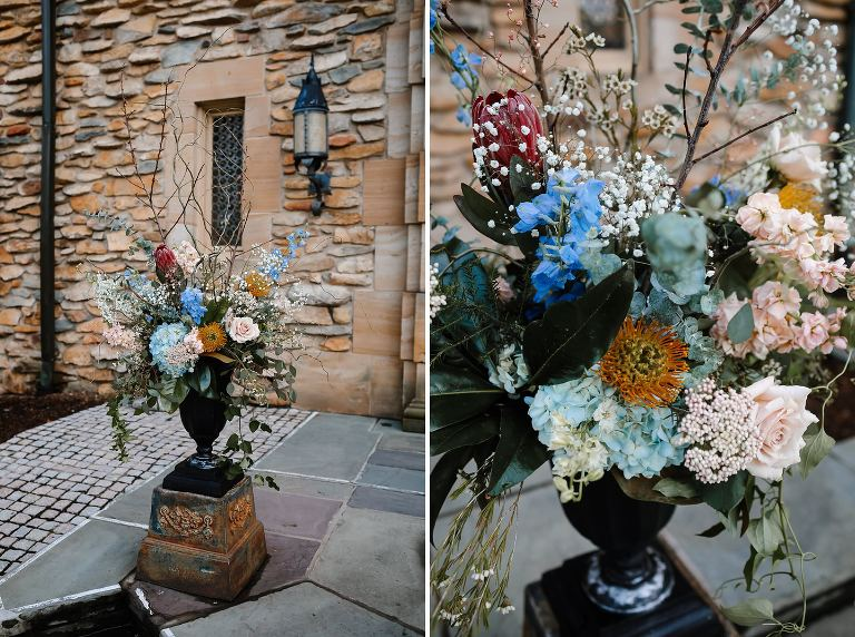 Large wildflower arrangement in urn in front of Graylyn main doors