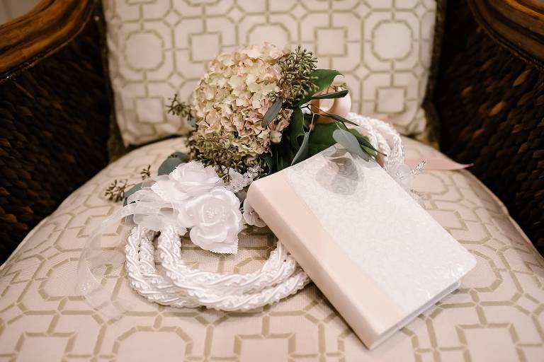 Detail photo of bridesmaid bouquet of hydrangea and seeded eucalyptus , white lasso and wedding bible