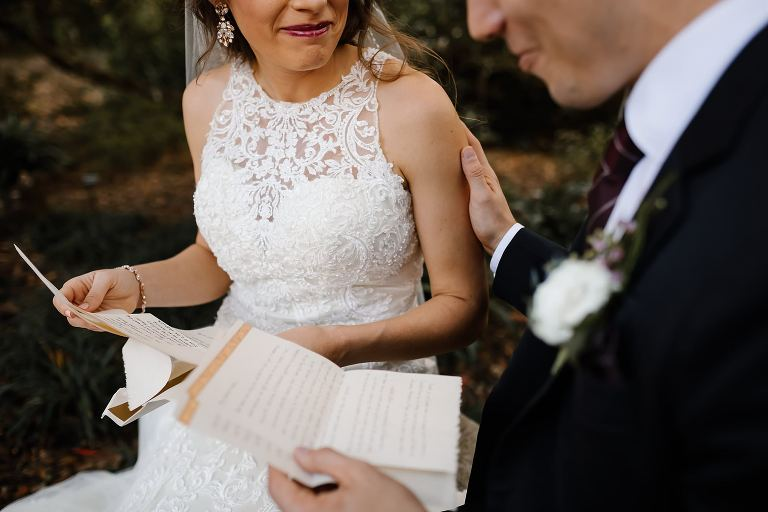 Close up of couple reading letters in a secluded corner of Bok Towers