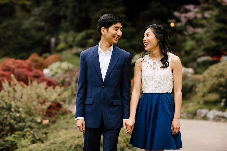 Couple walking closely together holding hands through Hakone Estate in Saratoga Ca